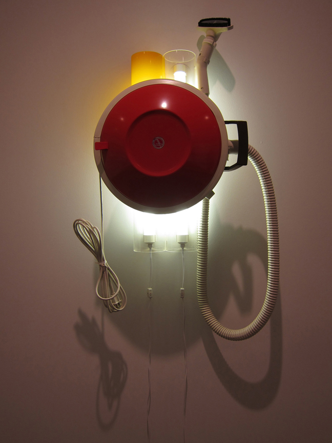 Hoover Celebrity /I, 1980, Vacuum cleaner, acrylic, and fluorescent lights, 38 x 20 x 11 in. (96.5 x 50.8 x 27.9 em), The Museum of Contemporary Art, Los Angeles, Gift of Lannan Foundation. Photo: @ Lidia Guibert Ferrara