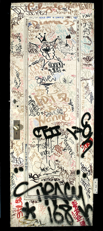 Door with graffiti tags from the studio of Jack Stewart, ca. 1970's. Metal, paint. New-York Historical Society, Gift of Regina Serniak Stewart, 2011.3