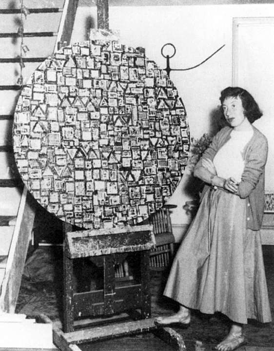 Lee Krasner with Stop and Go, c. 1949. Photographer unknown. © 2014 The Pollock-Krasner Foundation / Artists Rights Society (ARS), New York