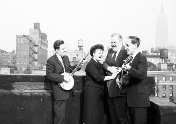 NEW YORK - DECEMBER 1958: Folk vocal group The Weavers (L-R: Erik Darling, Ronnie Gilbert, Lee Hays, Fred Hellerman) pose for a portrait in December, 1958 on a rooftop in Greenwich Village, New York City, New York. (Photo by David Gahr/Estate of David Gahr)