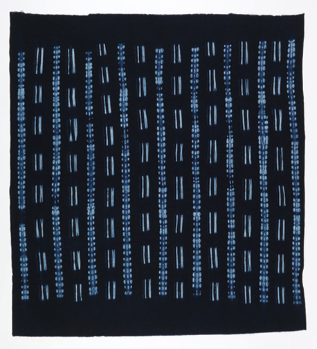 Adire wrapper. Gambia, ca. 1990. Indigo-dyed damask-woven cotton, patterned by machine-stitched resist. 143.5 × 132 cm (56 1/2 × 51 15/16 in.). Museum purchase from General Acquisitions Endowment Fund, 1993-136-2. Photo: Matt Flynn.