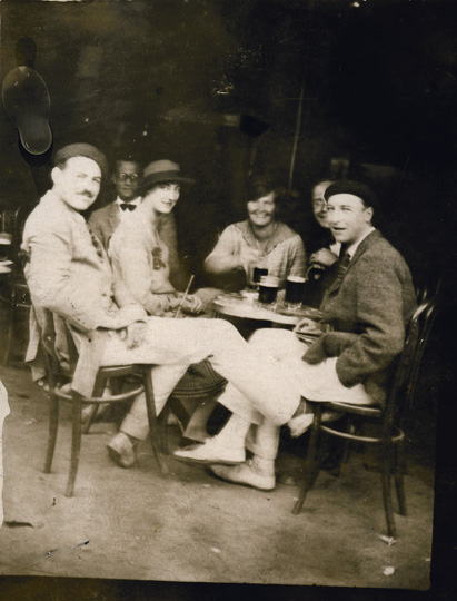 "EH5734P ca. Summer 1925 (L-R) Ernest Hemingway, Harold Loeb, Lady Duff Twyson (wearing hat), Hadley Hemingway, Don Stewart and Pat Guthrie sitting at a cafe. Pomplona, Spain. ' Please credit ""Ernest Hemingway Collection. John F. Kennedy Presidential Library and Museum, Boston"""