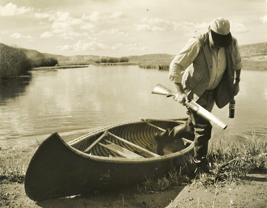 "EH4828P EH getting out of canoe, duck hunting in Idaho Please credit ""Ernest Hemingway Collection. John F. Kennedy Presidential Library and Museum, Boston"""