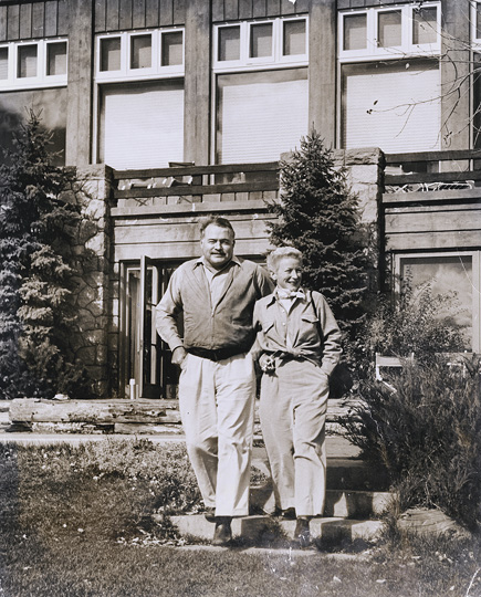 EH4972P c. 1947 Ernest Hemingway and Mary Hemingway outside of their Sun Valley, Idaho lodge. [Damage to photograph on the bottom-center and bottom-left; discoloration, fogging in several places]. Idaho 1939-1961: Box 14, Folder 16 Please credit: Unknown. Ernest Hemingway Photograph Collection. John F. Kennedy Library and Museum, Boston.