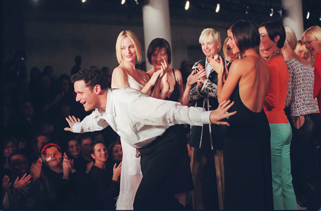 Isaac Mizrahi with models at the showing of his 1997 spring collection.