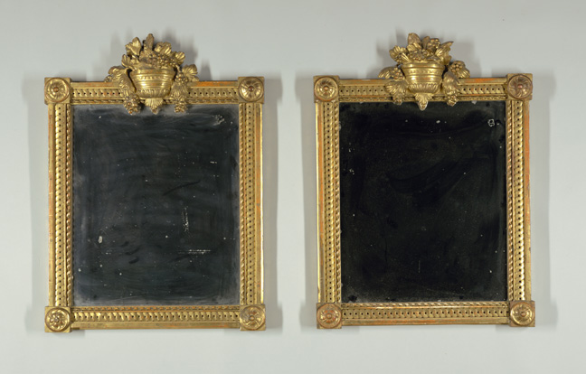 Pair of mirrors. France, 19th century. Carved and gilt wood, mirrored glass. H x W x D (a): 70.5 x 52.5 x 8 cm (27 3/4 x 20 11/16 x 3 1/8 in.); H x W x D (b): 70 * 52.5 * 7 cm (27 9/16 * 20 11/16 * 2 3/4 in.). Bequest of Mary Hayward Weir, 1968-158-17-a,b.