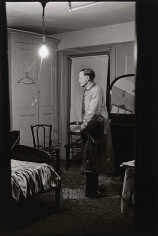 Diane Arbus. The Backwards Man in his hotel room, N.Y.C. 1961.
