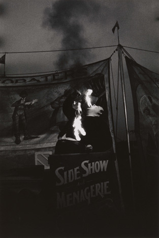 Diane Arbus. Fire Eater at a carnival, Palisades Park, N.J. 1957.