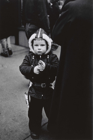 Diane Arbus. Kid in a hooded jacket aiming a gun, N.Y.C. 1957.