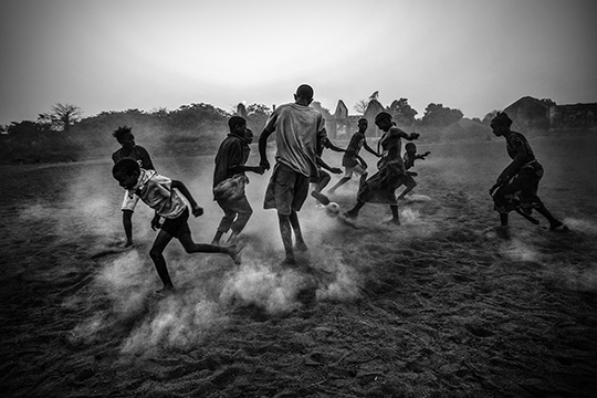 Daniel Rodrigues (Portuguese, born France 1987). Football in Guinea Bissau, March 3, 2012, printed 2016. Inkjet print, 13 5/16 x 20 in. (33.9 x 50.8 cm). Courtesy of the artist