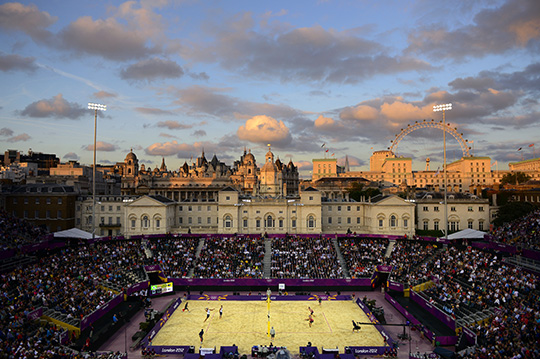 Donald Miralle (American, born 1974). Men's Beach Volleyball match between Brazil and Canada, London Olympics, The Horse Guards Parade ground, London, 2012. Archival inkjet print, 40 x 60 in. (101.6 x 152.4 cm). Leucadia Photoworks Gallery, courtesy of the artist