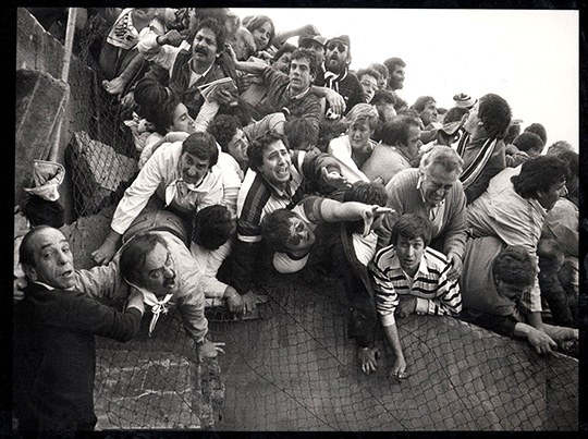 Eamonn McCabe (British, born 1948). Heysel Stadium Disaster, 1985. Gelatin silver photograph, 16 x 20 in. (40.6 x 50.8 cm). Courtesy of the artist