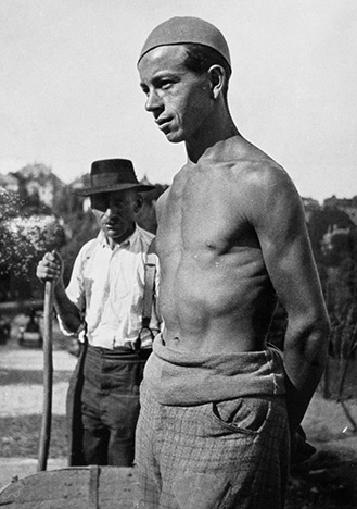 6. Untitled [Shirtless Man and Peasant, Hungary], 1933