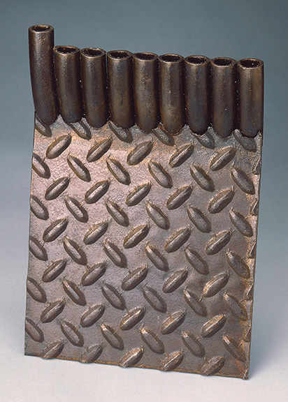 Larry Kagan, Menora 2, 1980, steel diamond plate; steel tubing, 9? x 6? x 4 7/16 in. (23.2 x 15.6 x 11.3 cm). The Jewish Museum, New York Purchase: Judaica Acquisitions Fund, 1986-89