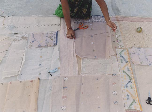 AppliquÈ artisans laying out jamdani scraps on a base panel, Gujarat, India, 2007.