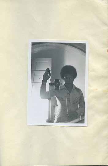 Beverly Buchanan (American, 1940–2015). Untitled (Self-Portrait in Mirror), 1977. Black-and-white photograph affixed to notebook paper, 11 x 8 ½ in. (27.9 x 21.6 cm). Private collection. © Estate of Beverly Buchanan