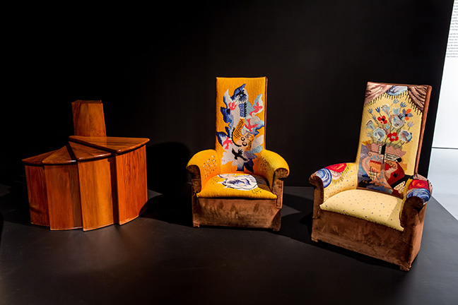 Left to right: Pierre Chareau, telephone fan table, c. 1924, wood. Private collection, New York; Pierre Chareau, Two high-backed chauffeuses (fireside armchairs), c. 1925, wood and velours, with tapestry upholstery by Jean LurÁat, reupholstered 1968. Private collection. From the exhibition Pierre Chareau: Modern Architecture and Design, November 4, 2016 ñ March 26, 2017, at The Jewish Museum, NY Photo: Will Ragozzino/SocialShutterbug.com. Exhibition design by Diller Scofidio + Renfro.