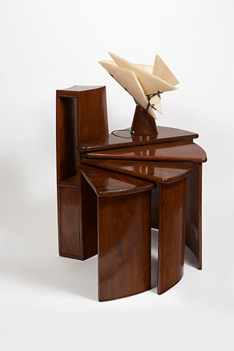 Telephone table (MB152) and Religieuse table lamp, c. 1924, designed by Pierre Chareau (French, 1883-1950). Table: walnut and patinated wrought iron; 31 3?4 ◊ 401?8 (extended) ◊ 15 in. (80.5 ◊ 102 ◊ 38 cm). Lamp: walnut, patinated wrought iron, and alabaster; 161?8 in. (41 cm) high. Collection Dominique Suisse