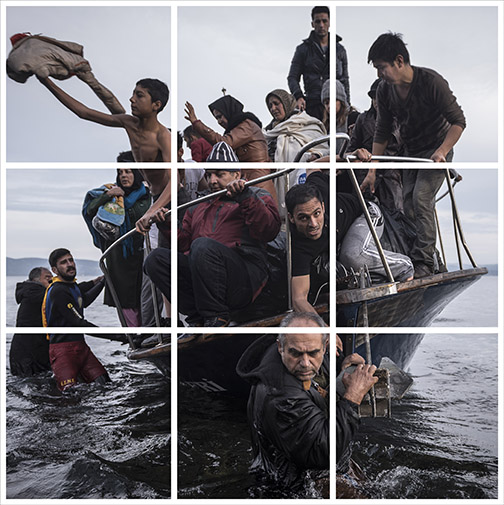 Migrants arrive by Turkish cruise boat near village of Skala, Lesbos island Greece, Monday November, 16, 2015. The Turkish boat owner delivered some 150 persons to the Greek coast and tried to escape back to Turkey, he was arrested later in Turkish waters.