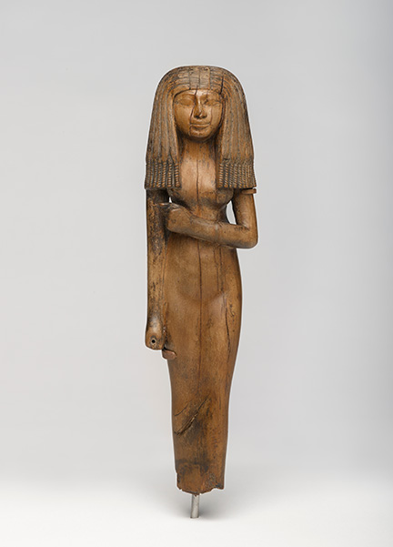 Statuette of a Woman, circa 1390-1353 B.C.E. Wood, 10 ⅛ x 2 ¾ x 1 ⅞ in. (25.6 x 7 x 4.8 cm). Charles Edwin Wilbour Fund, 54.29. (Photo: Jonathan Dorado, Brooklyn Museum)