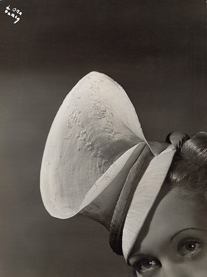 7. Madame d'Ora, Woman modeling a hat by Mme Agnès, ca. 1938. Photoinstitut Bonartes, Vienna